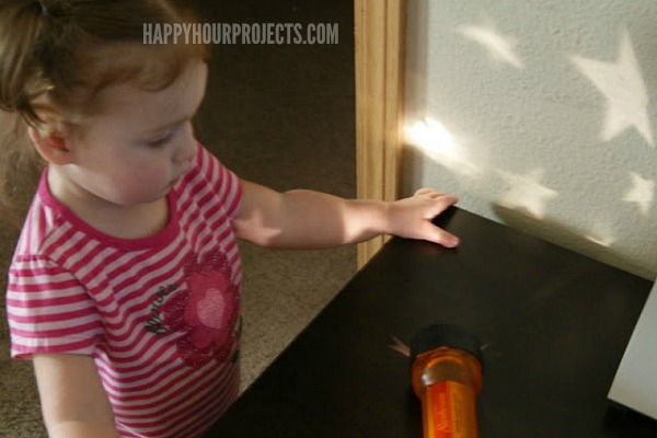 Easy Dollar Store Kids Activites | Starry Flashlight at www.happyhourprojects.com