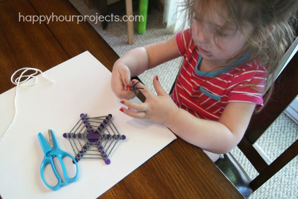 Kids' Halloween Craft: Popsicle Stick Spiderwebs at www.happyhourprojects.com