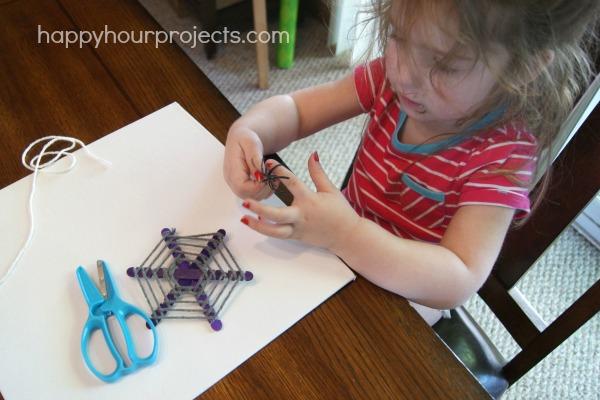Kids' Halloween Craft: Popsicle Stick Spiderwebs at www.happyhourprojects.com