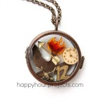 DIY Hunger Games Theme Locket at www.happyhourprojects.com