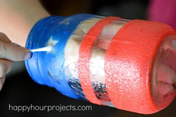 DIY Painted Patriotic Mason Jar Luminary at www.happyhourprojects.com