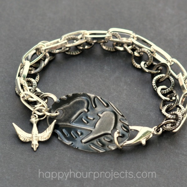 Embossed Metal Bird-Themed Charm Bracelet at www.happyhourprojects.com