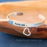 Stamped Charm Bangle & How to Add Eyelets to Metal Blanks at www.happyhourprojects.com