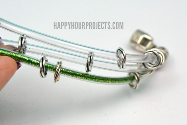 DIY Braided Glitter Bracelet Made From Plastic Tubing at www.happyhourprojects.com