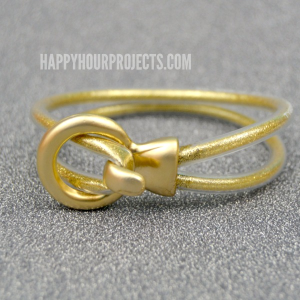 DIY Gold Glitter Looped Bracelet Made From Plastic Tubing at www.happyhourprojects.com