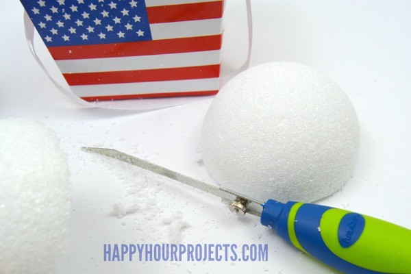 Faux Fireworks Patriotic Centerpiece at www.happyhourprojects.com | Use FloraCraft foam balls and household items to create this red white and blue decor piece! #MakeItFunCrafts