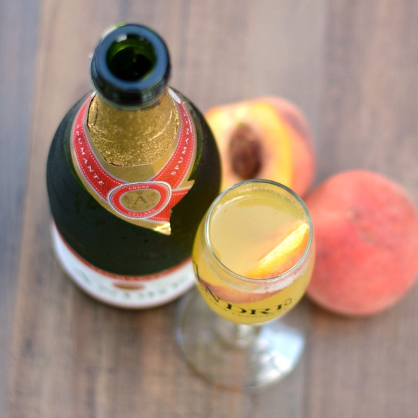 White Grape Peach Bellini Recipe | Perfect for brunch! at www.happyhourprojects.com