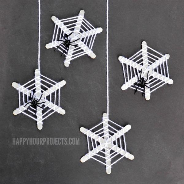 Halloween Crafts for Kids | Craft Stick Spiderwebs at www.happyhourprojects.com