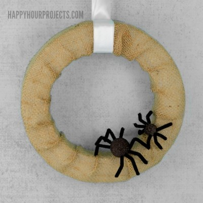 Spider Halloween Wreath Tutorial at www.happyhourprojects.com #MakeItFunCrafts