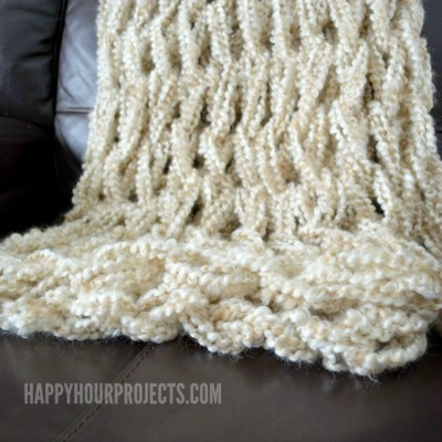 Arm Knitted Blanket Tutorial (Photo Step Outs and Video Versions) at www.happyhourprojects.com