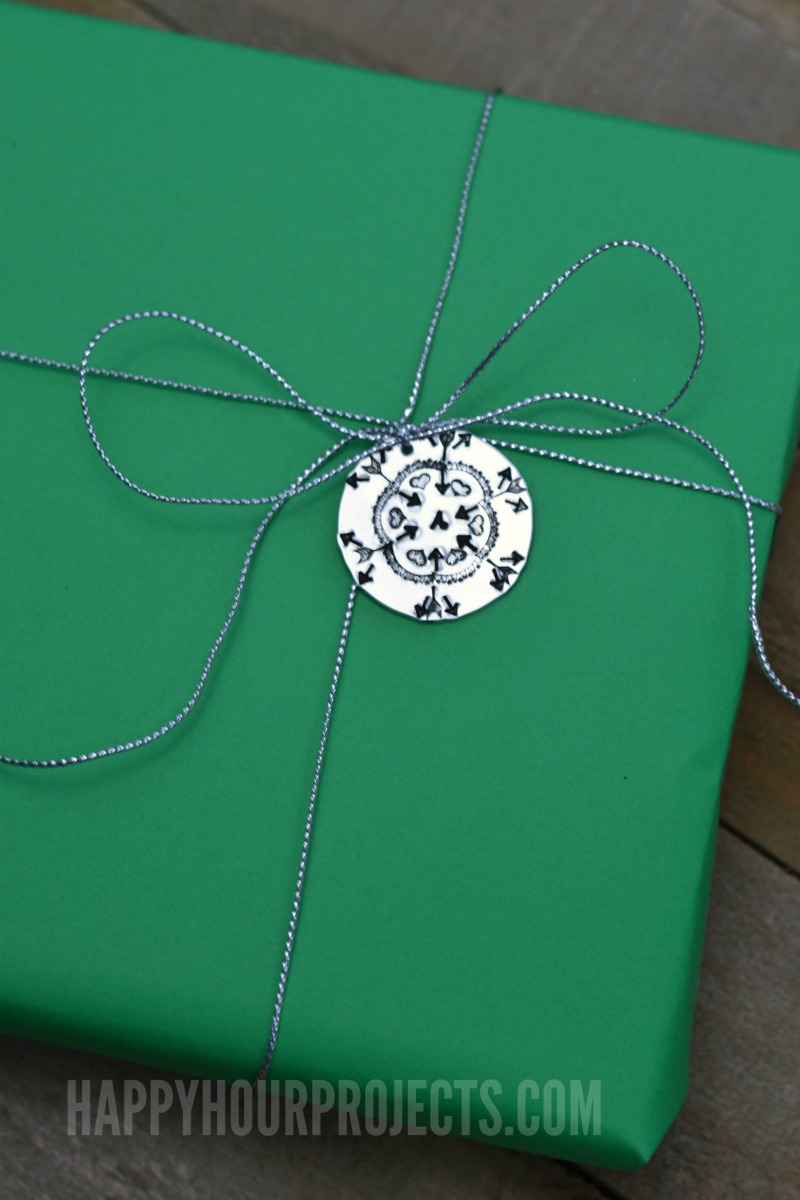 Hand Stamped Gift Tags | Using Design Stamps to Make Snowflakes at happyhourprojects.com