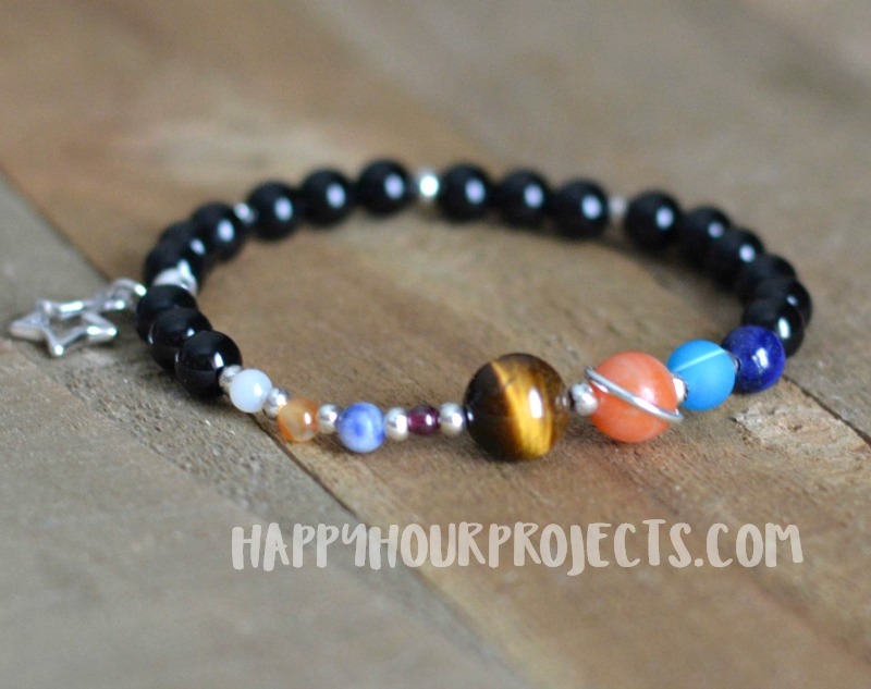DIY Solar System bracelet at happyhourprojects.com | This DIY features gemstone beads and pewter elements on a simple stretch cord. A fun DIY and a great science lesson too! #science #space #DIY #jewelry