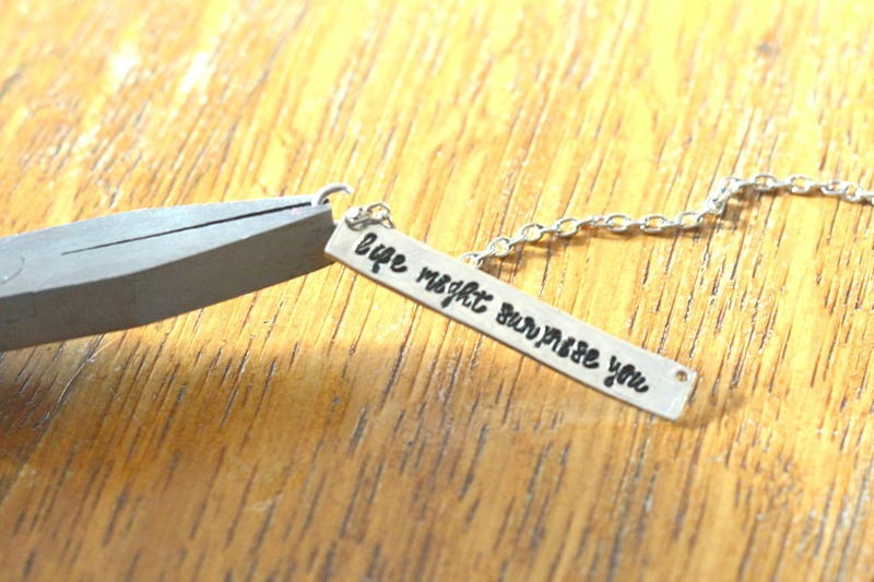 DIY Hand Stamped Bar Necklace at happyhourprojects.com | Use script fonts like ImpressArt's Charlotte to fit more text on personalized pieces!