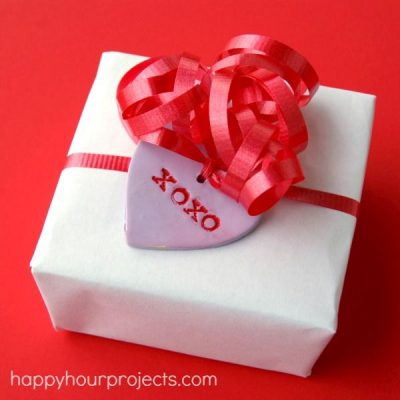 Make Easy Polymer Clay conversation heart tags for Valentine's Day at happyhourprojetcs.com!