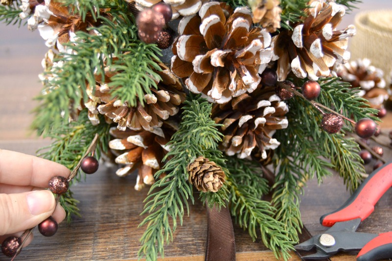 DIY Pinecone Kissing Ball at happyhourprojects.com | Make this Christmas wreath alternative for your DIY Christmas decor this year!  A DIY Pinecone kissing ball looks great all winter, and it's so easy to make!