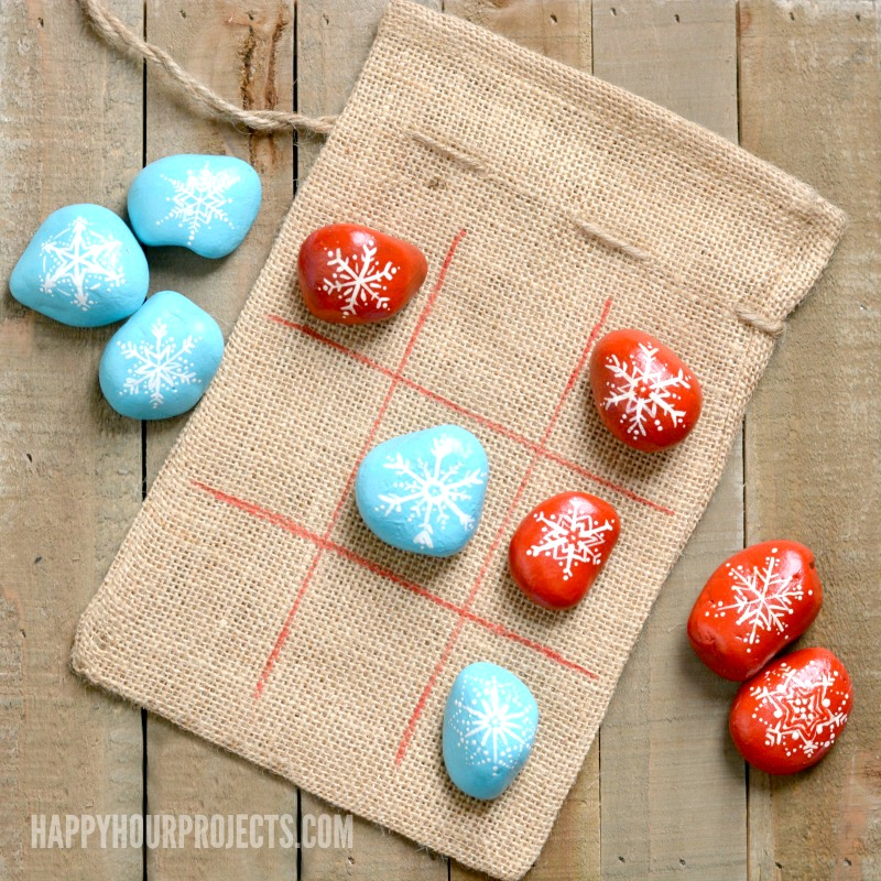Painted rocks Tic Tac Toe at happyhourprojects.com | Make this fun tic tac toe set this season! It's portable, kid-friendly, easy to make, and a great little boredom-buster!